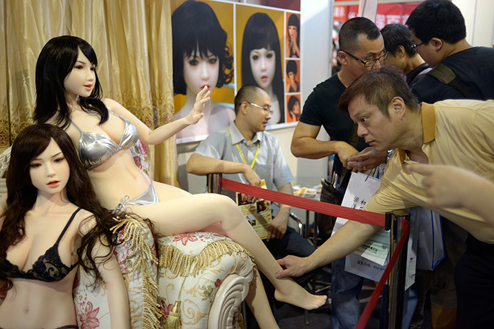 Lifelike plastic sex dolls on display