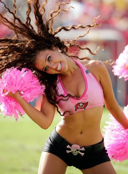 A Tampa Bay Buccaneers cheerleader during the fourth quarter of an NFL football game against the Philadelphia Eagles Sunday, Oct. 13, 2013, in Tampa, Fla. (AP Photo/Chris O'Meara)